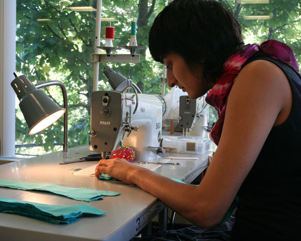 Fashion Design Student Working on Sewing Machine