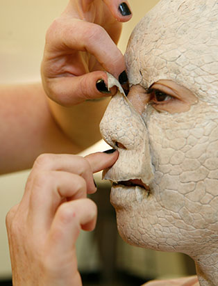 celine godeau applying makeup prosthetic