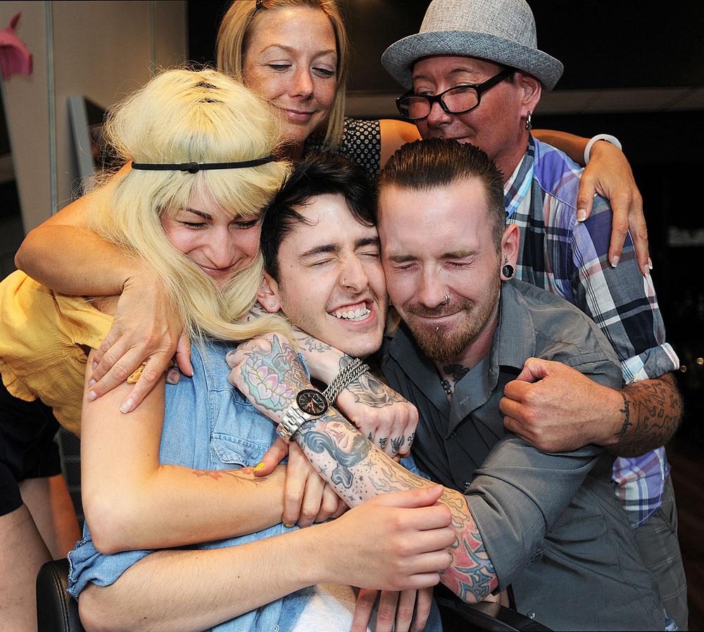 dylan walker hair school graduate coworker group hug