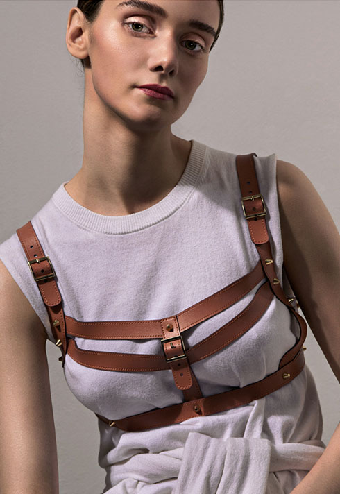 sarah danniels fashion marketing grad leather harness white tshirt