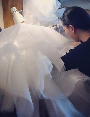 top fashion design graduate wen chee liu sewing skirt