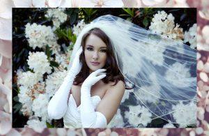bride against flowers by julie brown