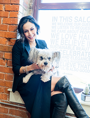 ana luisa laughing with dog in her hair studio ana luisa valdez cutting hair at her studio in gastown pro hair school graduate blanche macdonald centre vancouver bc canada