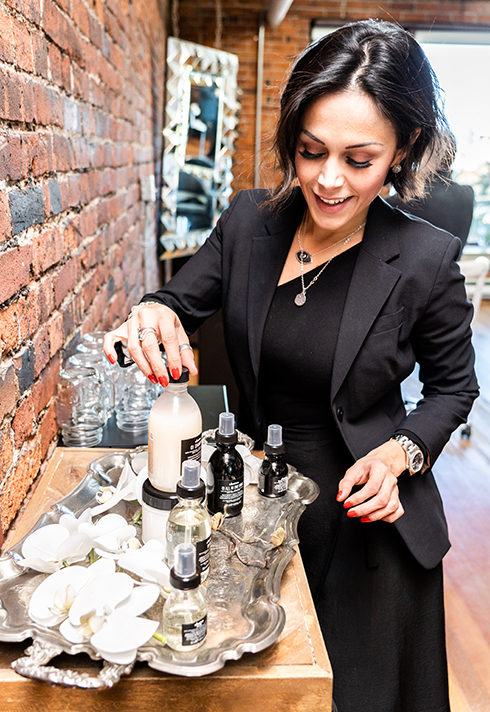 ana luisa with tray of davines products at flowstate salon pro hair school ana luisa valdes gastown yvr vancouver canada