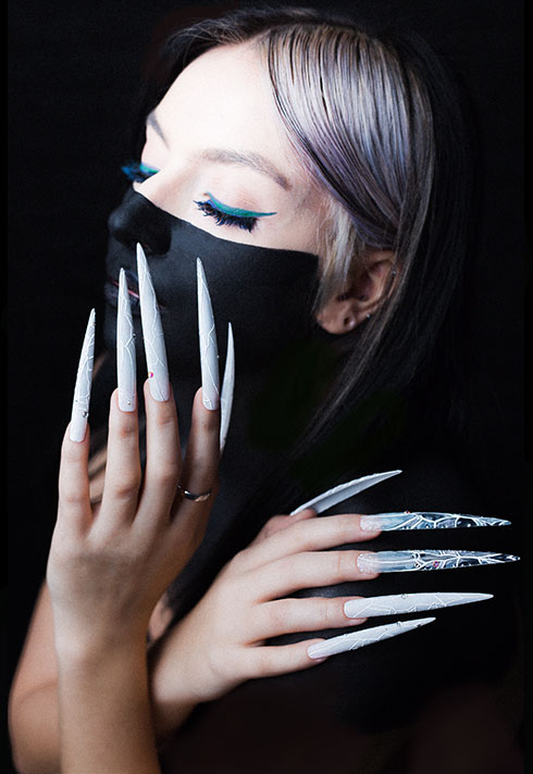 top beauty school graduate paige roy long icey nails