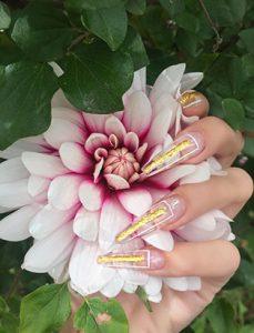 top nail school graduate paige roy gold geometric nails
