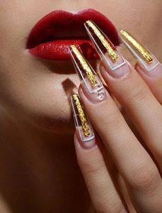 top beauty school graduate paige roy red lips gold nails
