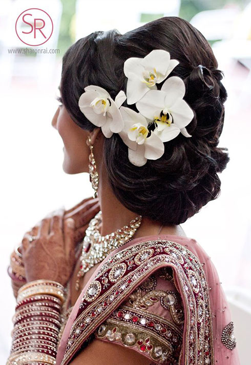 sharon rai bridal makeup pinned hair with orchids