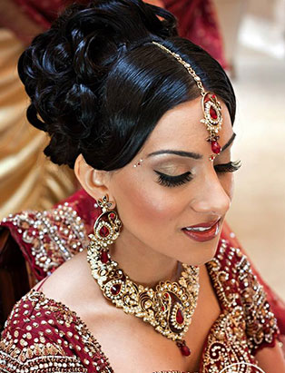 sharon rai bridal makeup red sari pinned curls