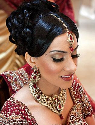 sharon rai bridal makeup red sari pinned curls