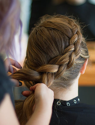 eliza trendiak salon owner braiding hair