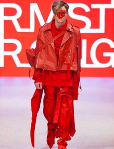top fashion design school graduate instructor red leather cape