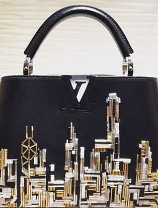 top fashion graduate brian chang visual merchandiser at louis vuitton skyline bag