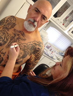 pepper gallegos applying makeup tattoos