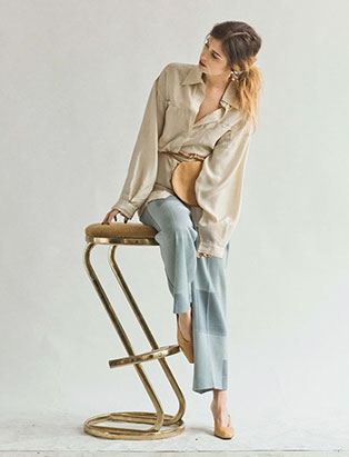 hey jude model leaning on stool