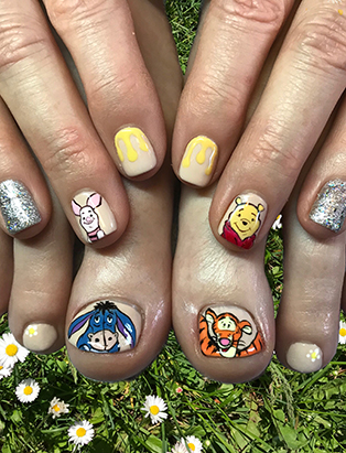 lana sheen winnie the pooh and tigger nails bmc nail artistry grad