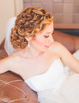 bridal undo curly pinned smiling