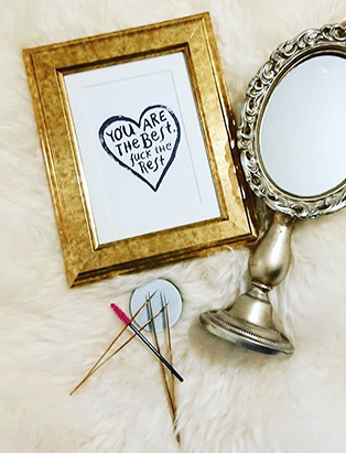 makeup tools from jojo esthetics with mirror and picture frame