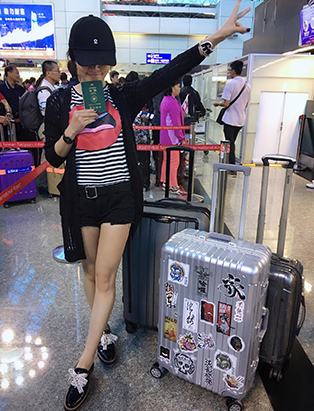 sunny lee at airport with luggage mua graduate bmc