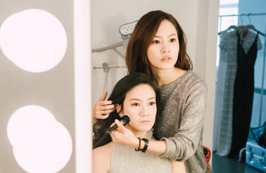 international makeup graduate sunny lee working with a bridal makeup client