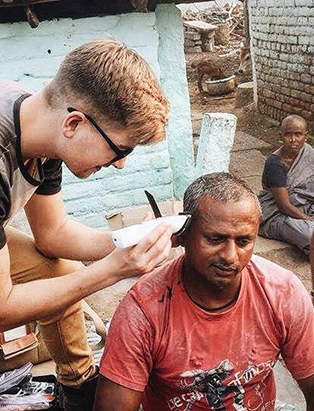 cody dunbar banche hair program graduate cutting hair in india