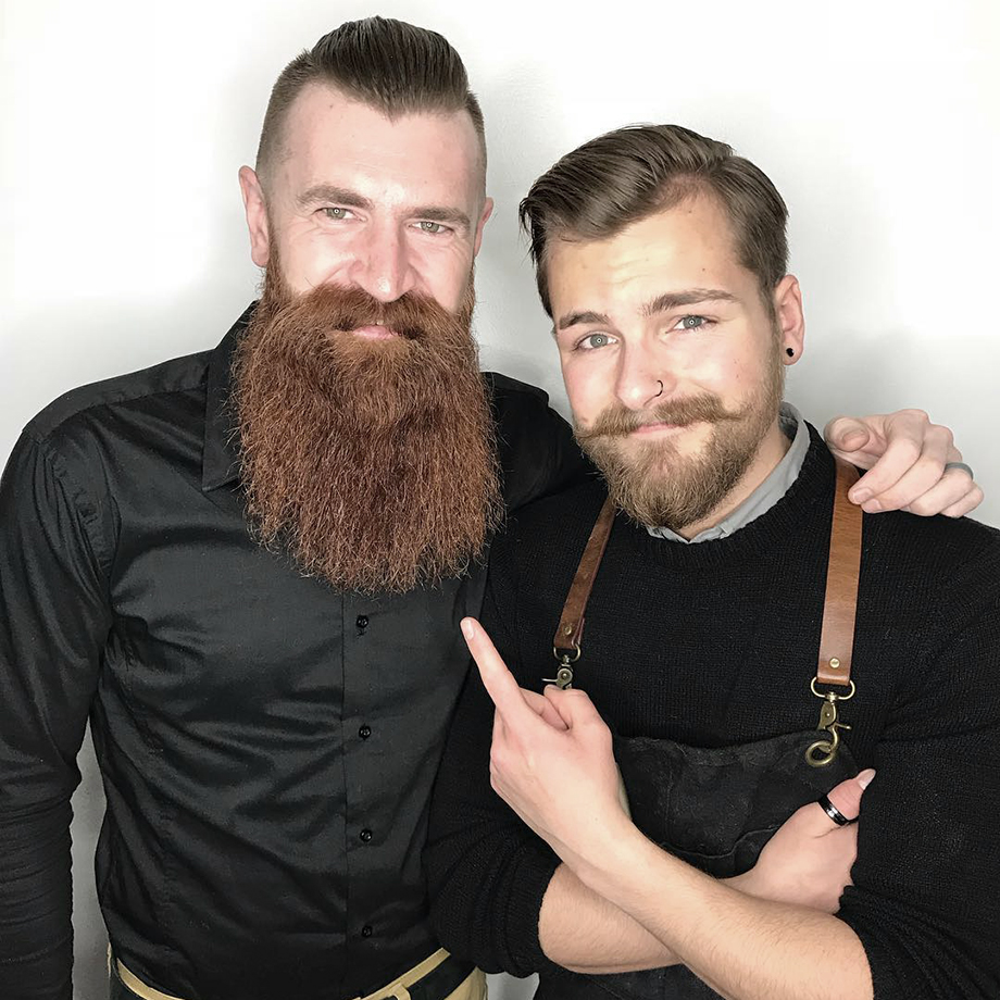 Barber and hairstylist and BMC graduate Cody Dunbar with a client at Bourbon Barber Shop Saskatchewan Canada