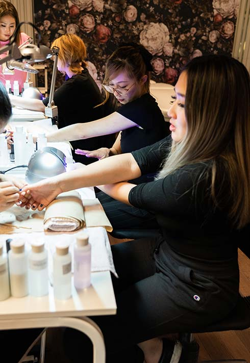 nail technician school students practicing nail design