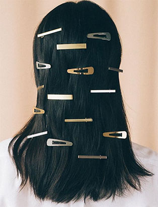 Blanche Macdonald hair program graduate Erin Klassen styles with hair clips