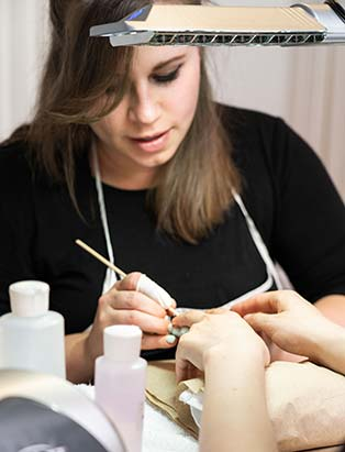 nail studio program student practicing gel nail soak off technique