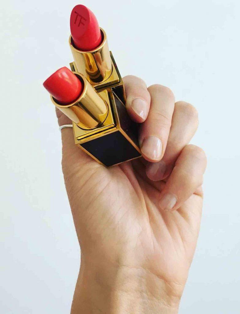 BMC graduate Lori Woodhouse holding Tom Ford lipstick