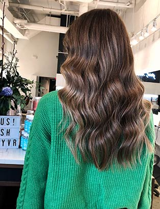 brown wavy long hair by Lara Dillman senior stylist at BLUSH Salon Vancouver and BMC graduate
