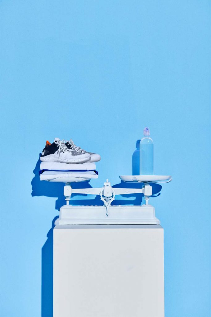 NIKE Sneakers and Waterbottle on a scale