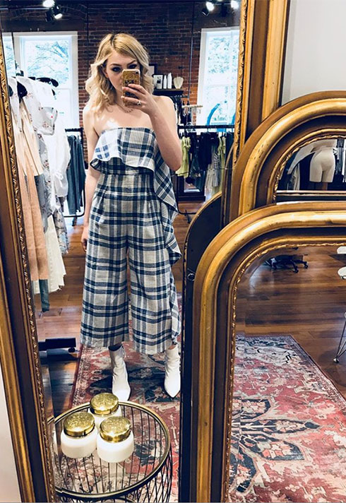 selfie wearing fashionable plaid jumpsuit and white boots