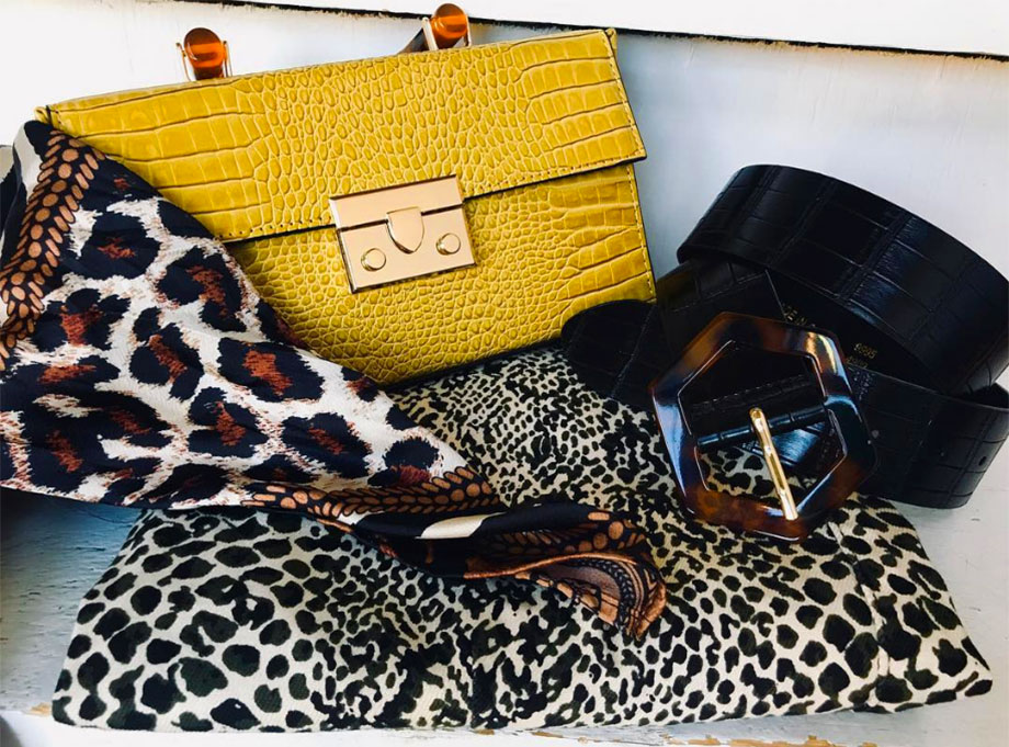 still life of fashion accessories with animal print