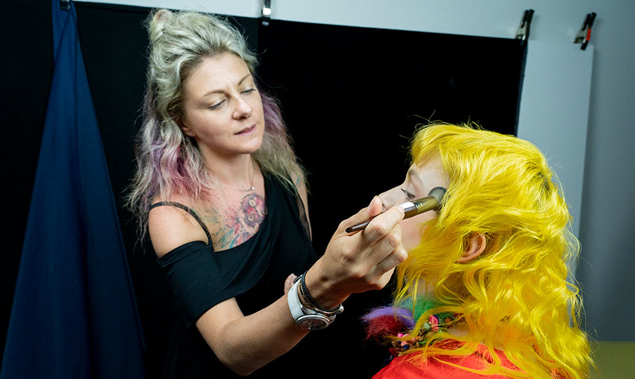 BMC pro makeup graduate Jana Bizzari applying makeup at an editorial shoot