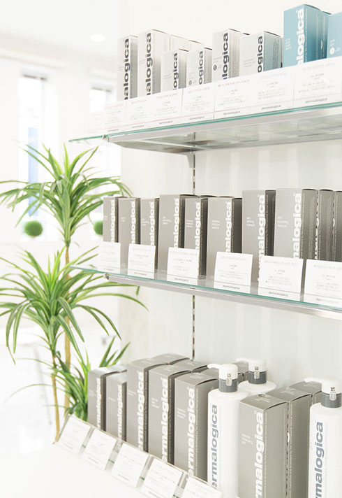 Shelves featuring Dermologica products in Tomoko Tajima's Trinity Facial Spa