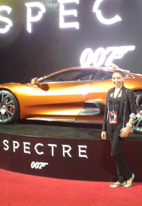 Blanche Macdonald graduate Alejandra Hernandez standing in front of car at the 007 Spectre premiere