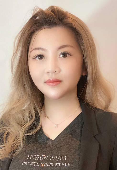 nail artist and BMC graduate Jamie Yin wearing her Swarovski Authorized Nail Art Educator t-shirt