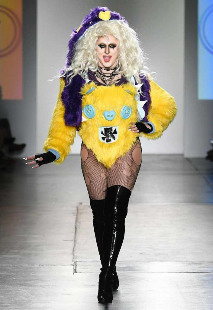 drag queen model at NYFW wearing yellow faux fur look by Haus of Zuk