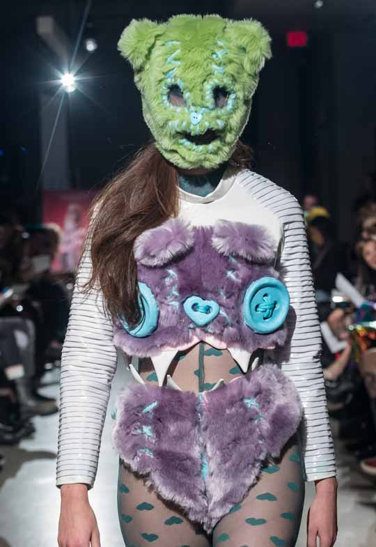 model wearing green bear mask and purple faux fur by Peter Zuk at BMC grad show