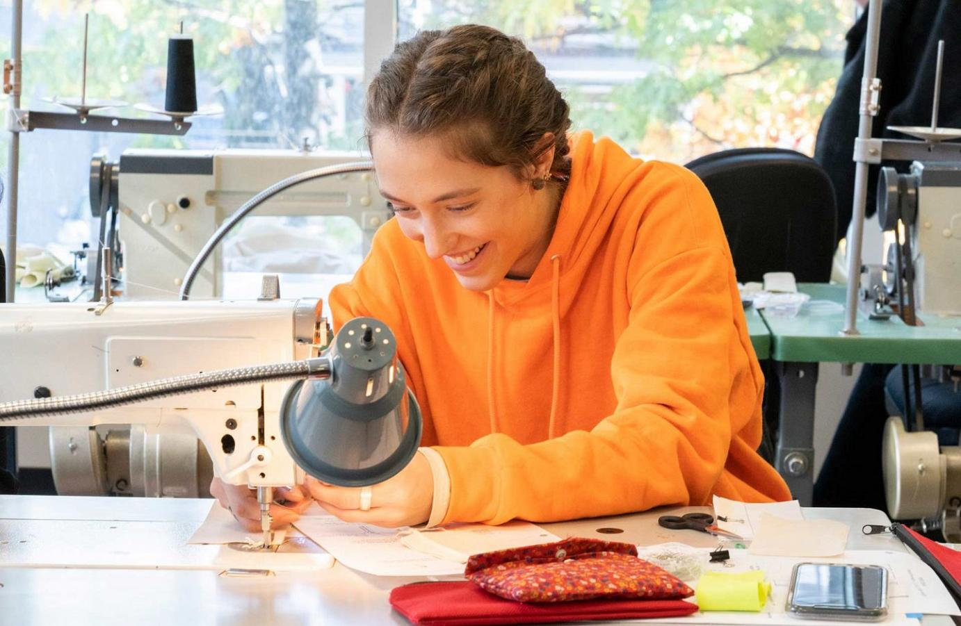 fashion design student sewing at Blanche Macdonald's Robson campus