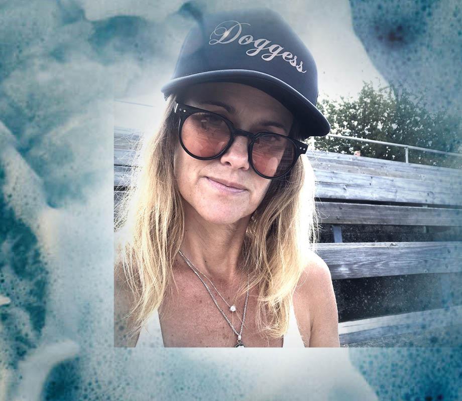 BMC Fashion Design graduate Katie Quinn wearing a navy Doggess hat she designed