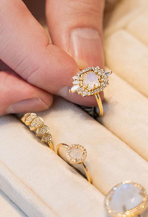 closeup of Melanie Auld rings in case