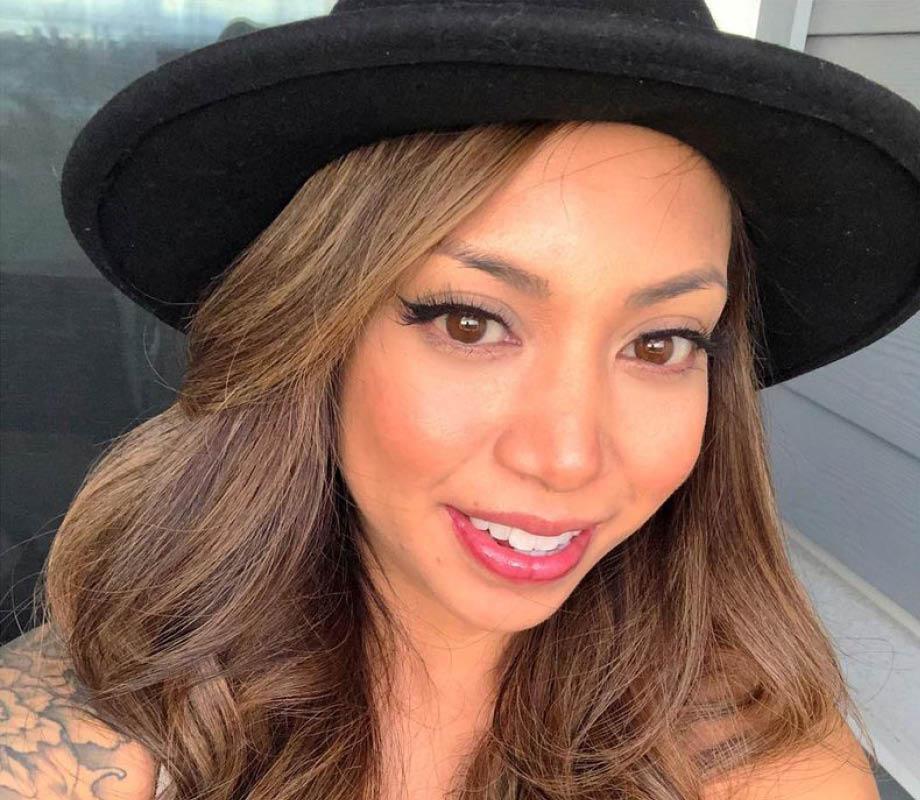 Blanche Macdonald Pro Makeup Program Graduate April Pangilinan wearing hat
