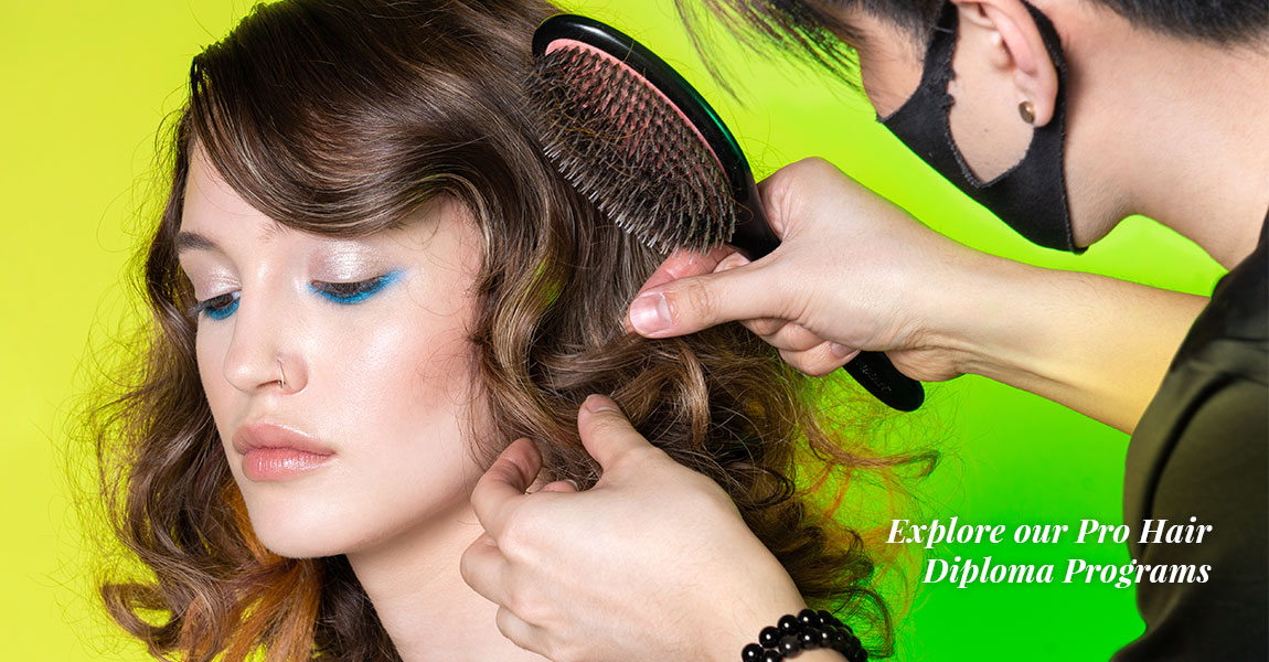Freddy Sim does touch ups to model's hair at photoshoot