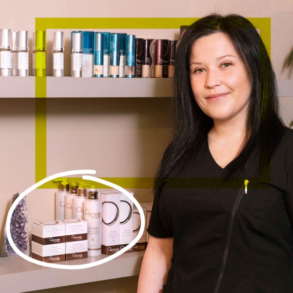 BMC esthetics graduate Christina Makrodimitras standing in front of products