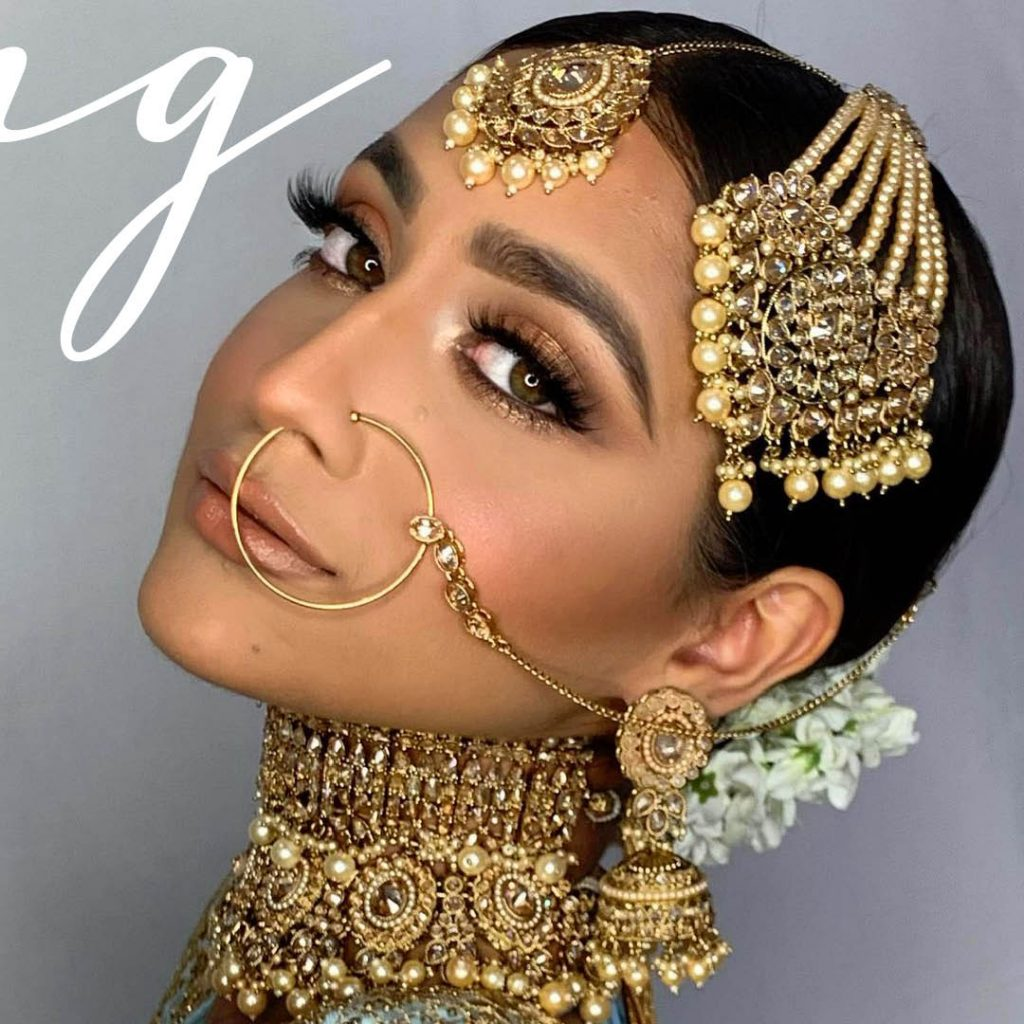 bride with copper eyeshadow look by Southeast Asian bridal specialist Sukhi Lidher